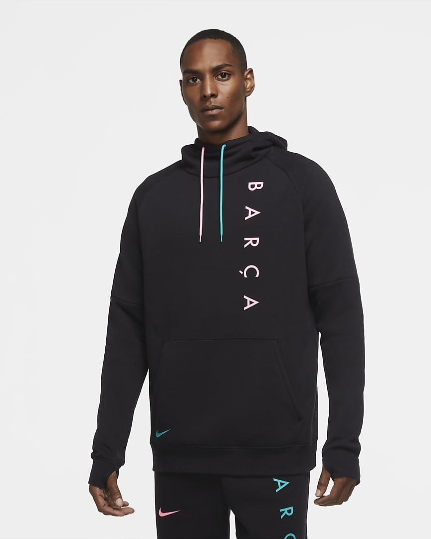 "Model wearing the black hoodie with pink and blue ties and ""Barca"" written in pink down the side"