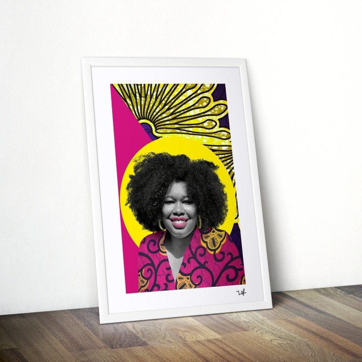 a woman with a big curly afro. Her face and hair are in black and white but her lipstick and shirt are fuchsia.