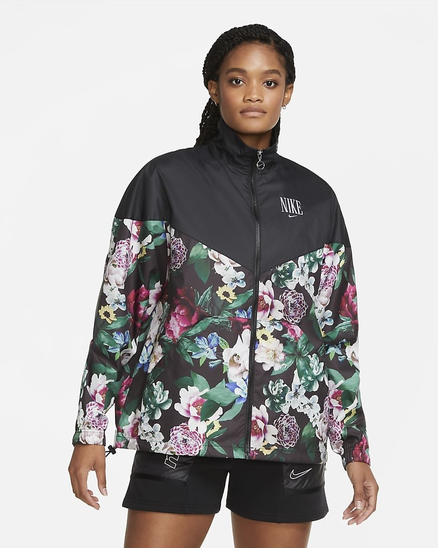 Model wearing the full-zip jacket with 3/4th with a floral print and black color-block on top