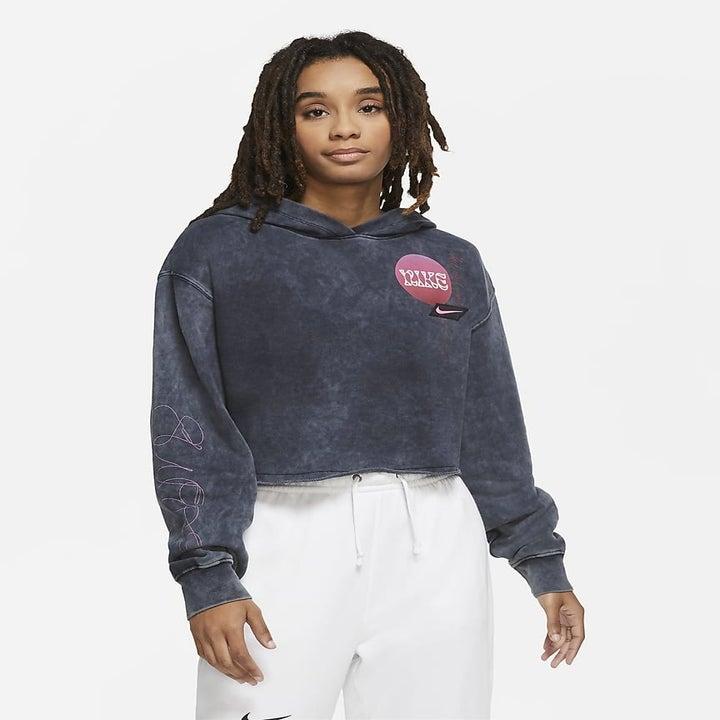 Model wearing the cropped hoodie in dark grey