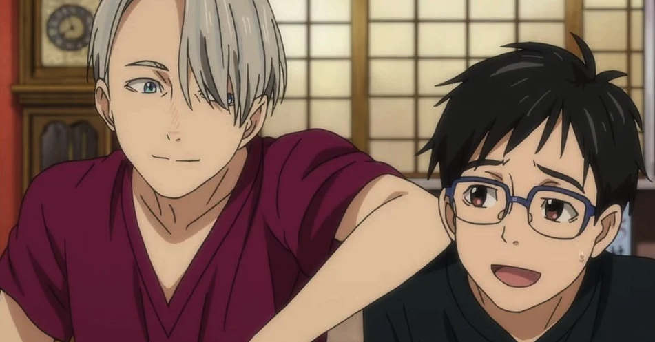 Yuri and Victor sitting next to each other, laughing and smiling