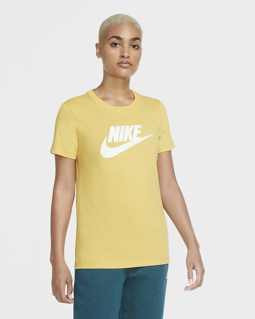 Model wearing the t-shirt in yellow with white nike logo on it