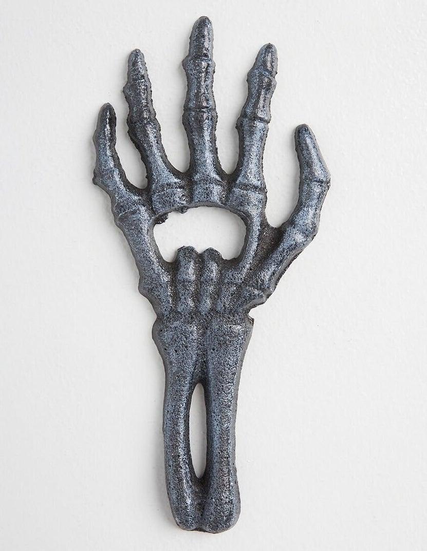 sparkly grey skeleton hand bottle opener