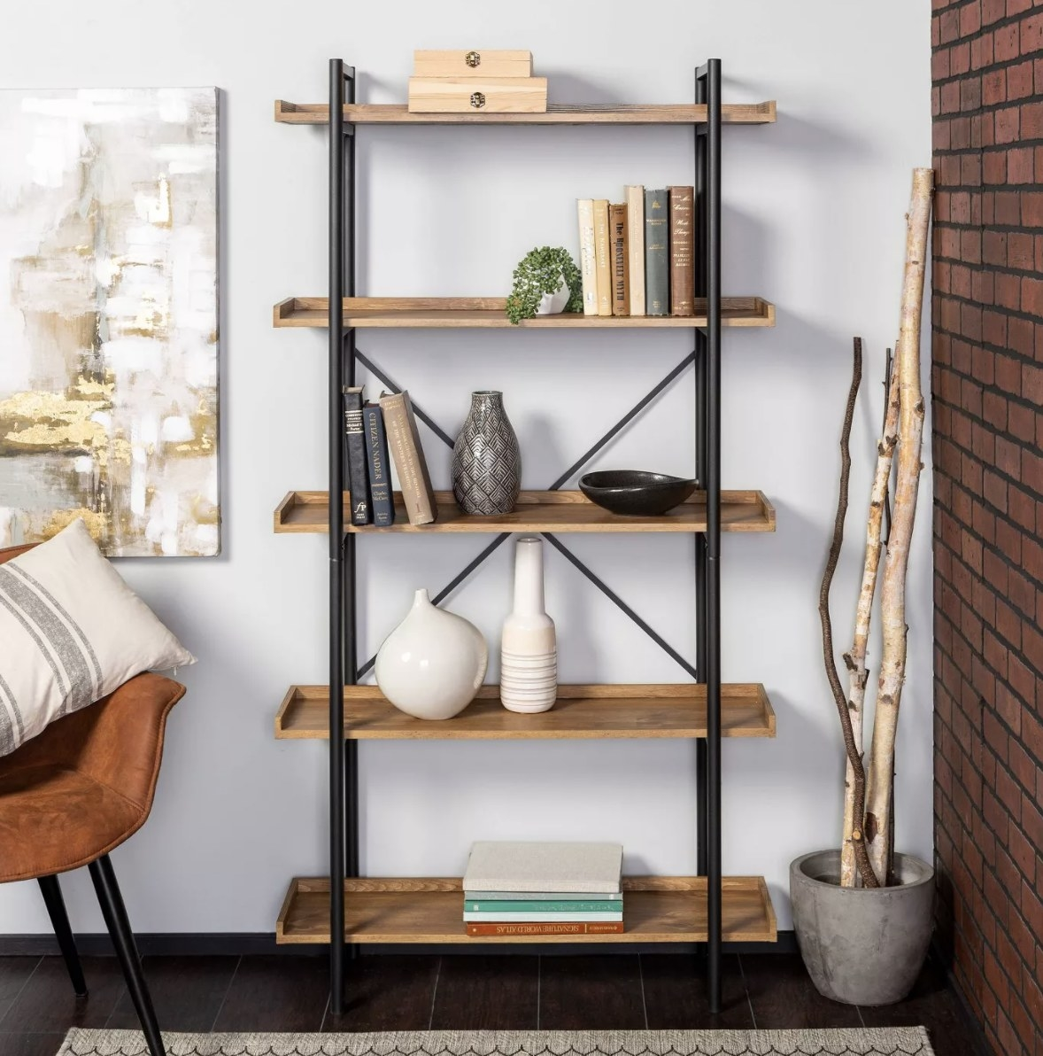 the bookshelf with books, vases, and a plant filled inside of it