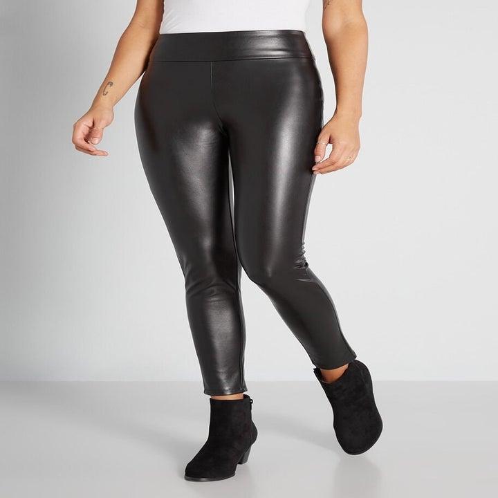 model wearing black faux leather leggings
