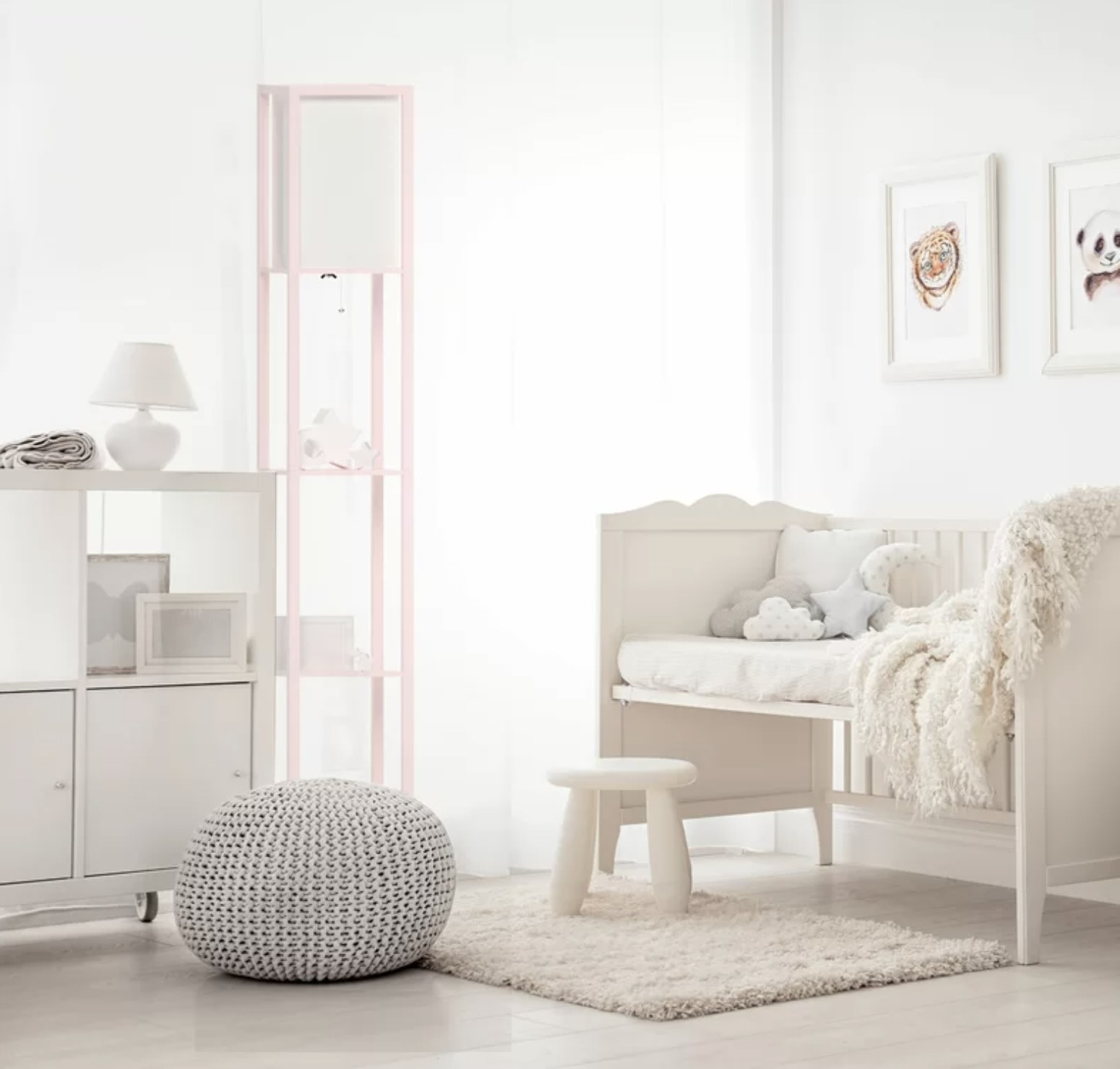 The pink floor lamp with shelves in a nursery