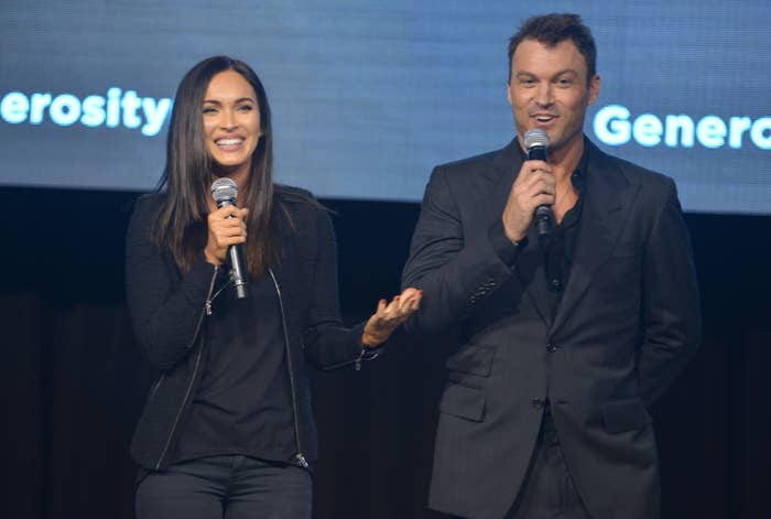 Actors Megan Fox and Brian Austin Green speak on stage at the 6th Annual Night of Generosity Gala presented by generosity.org at the Beverly Wilshire Four Seasons Hotel on December 5, 2014 in Beverly Hills, California