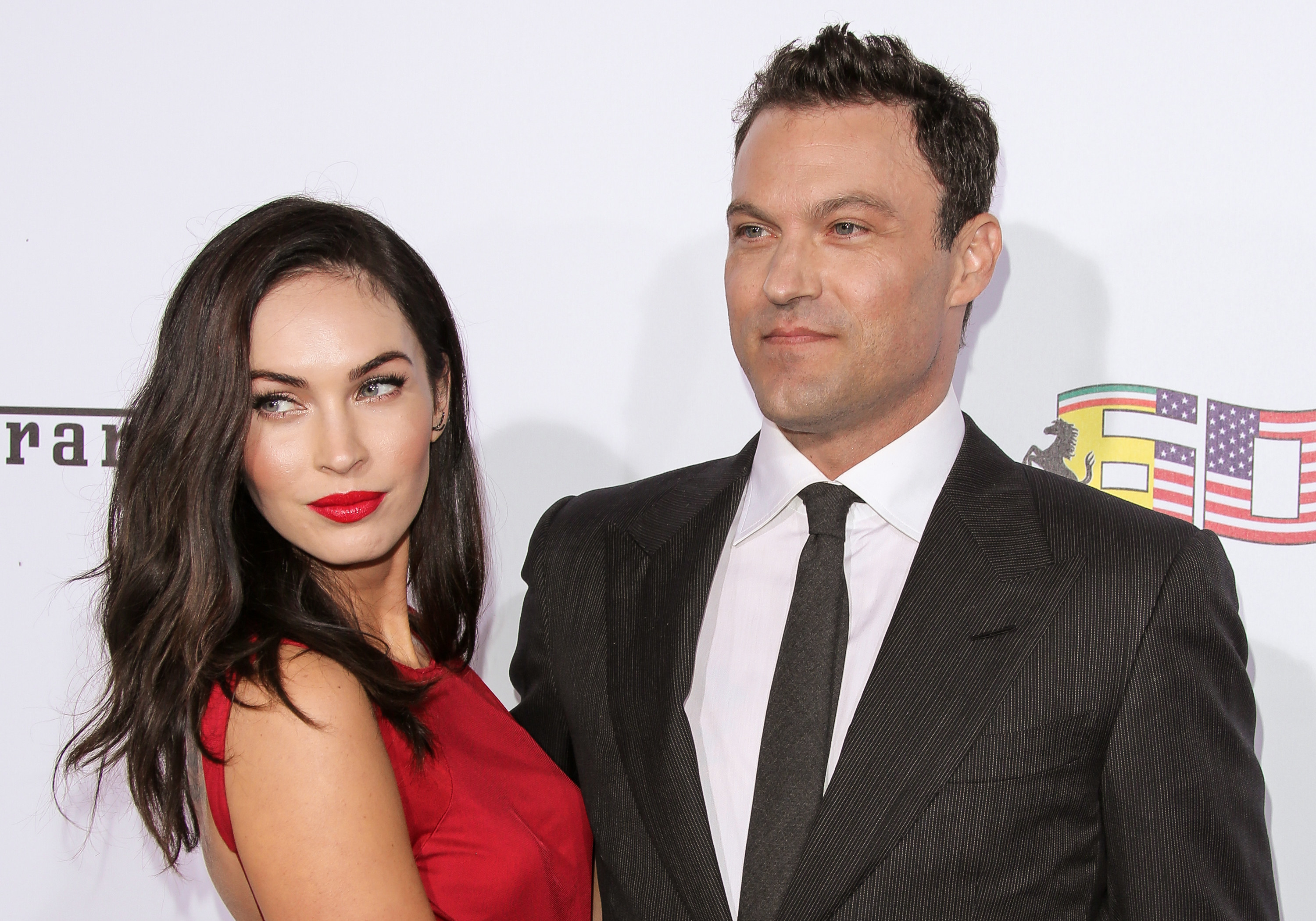 Actors Megan Fox (L) and Brian Austin Green (R) attend Ferrari's 60th Anniversary In The USA Gala at the Wallis Annenberg Center for the Performing Arts on October 11, 2014 in Beverly Hills, California