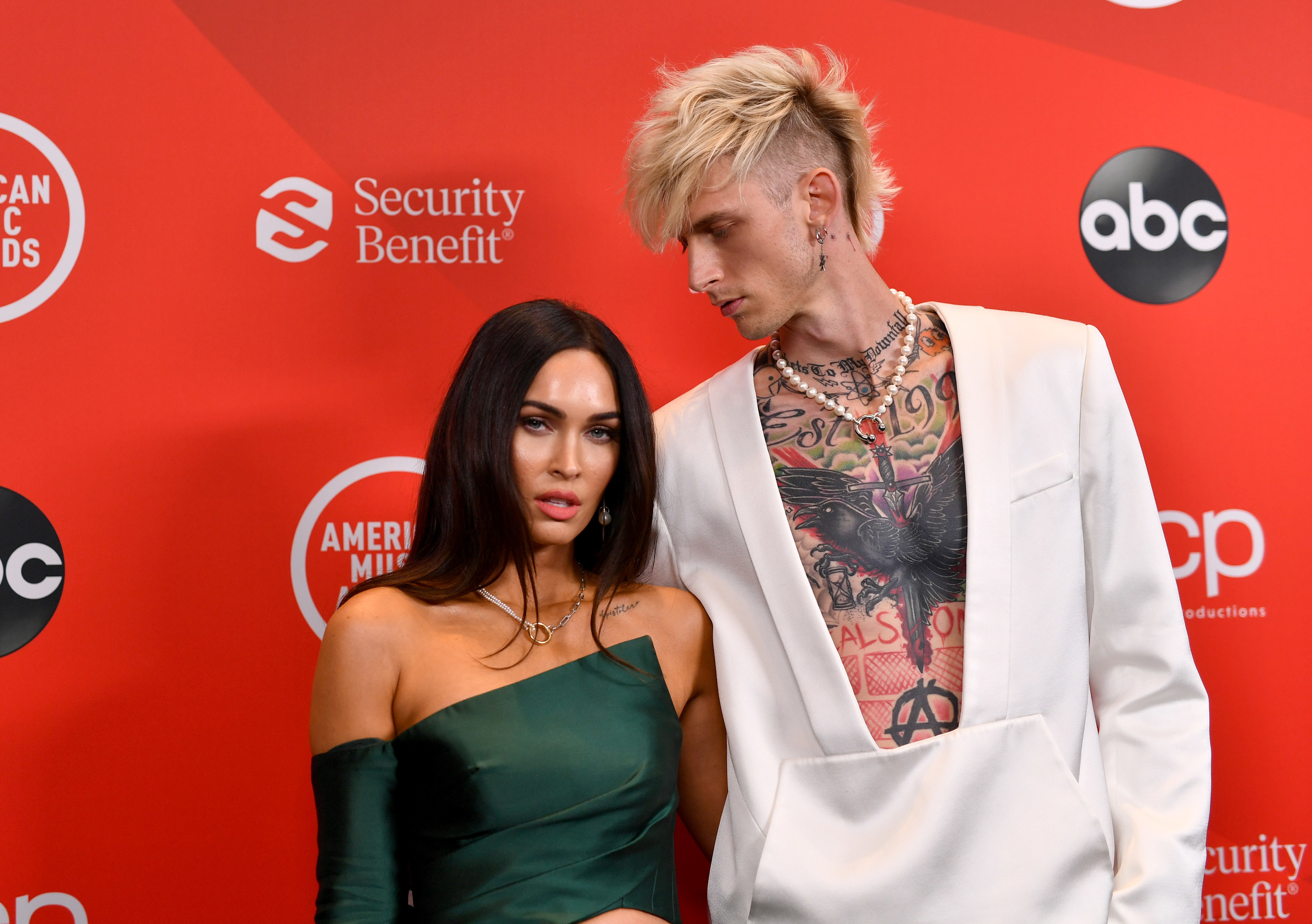 Megan Fox and Machine Gun Kelly attend the 2020 American Music Awards at Microsoft Theater on November 22, 2020 in Los Angeles, California