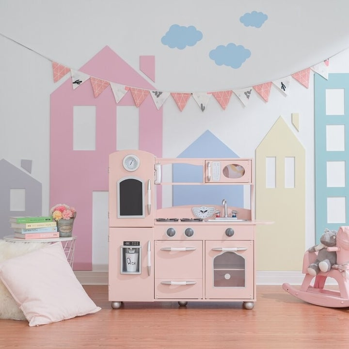 The wooden play set in pink