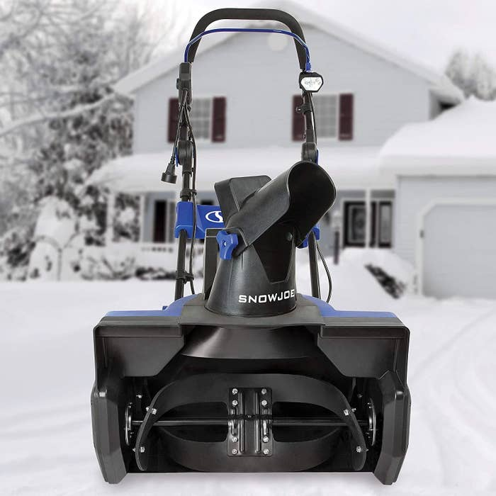 The snow blower in front of a house