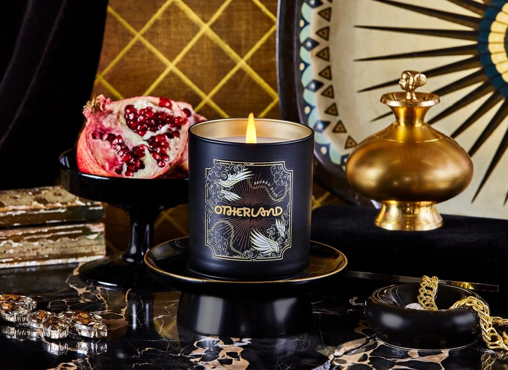 black candle with winged design