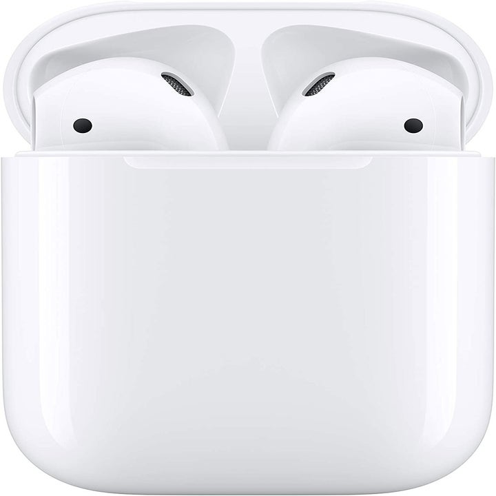 Two white wireless earbuds in charging case
