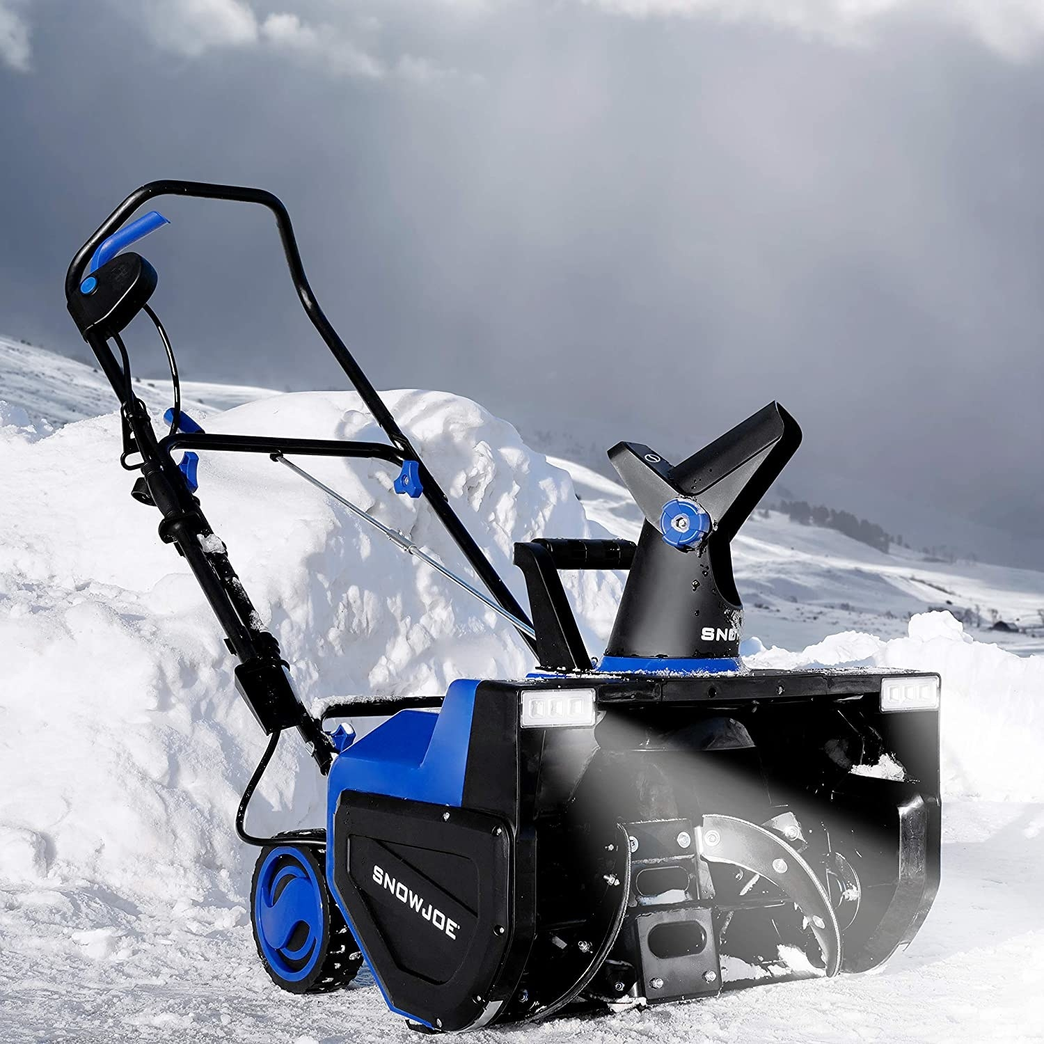 The snow blower in front of a pile of snow