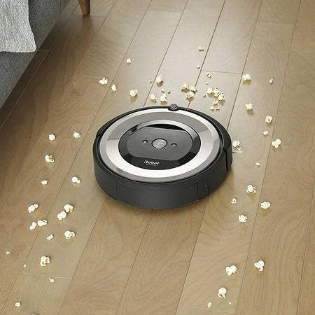the circular robot vacuum cleaning popcorn