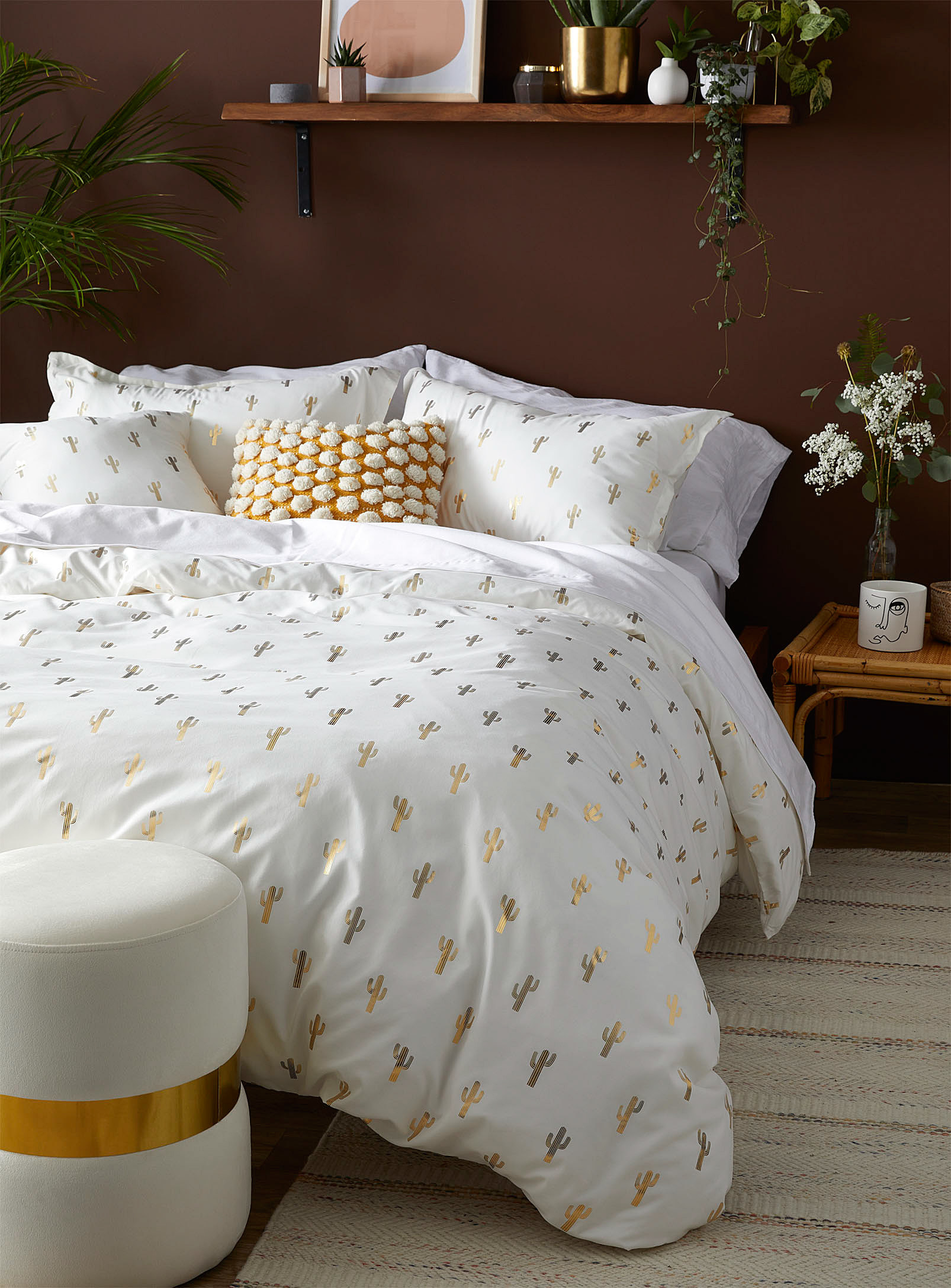 A thick duvet on a bed with pillows