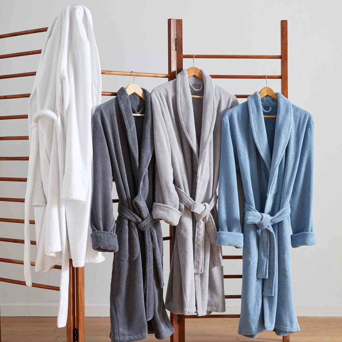 four robes in white, grey, slate, and blue