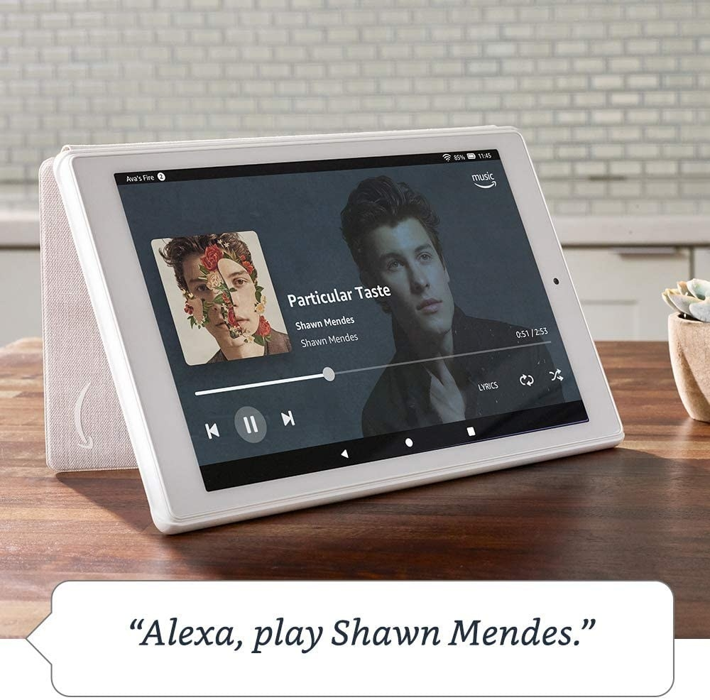 "A tablet propped on a table with the command ""Alexa, play Shawn Mendes"" on it"