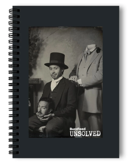 Notebook with image of two people, one person holding a head in his hands and the other person headless