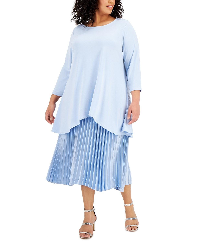 model wearing Alfani handkerchief-hem top in faded blue