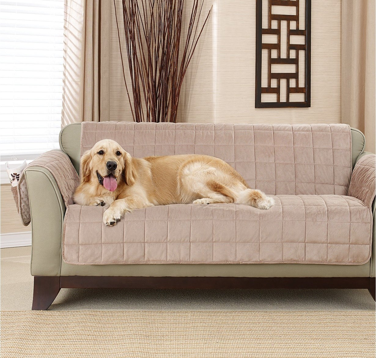 golden retriever laying on a couch with the pet slipcover on it
