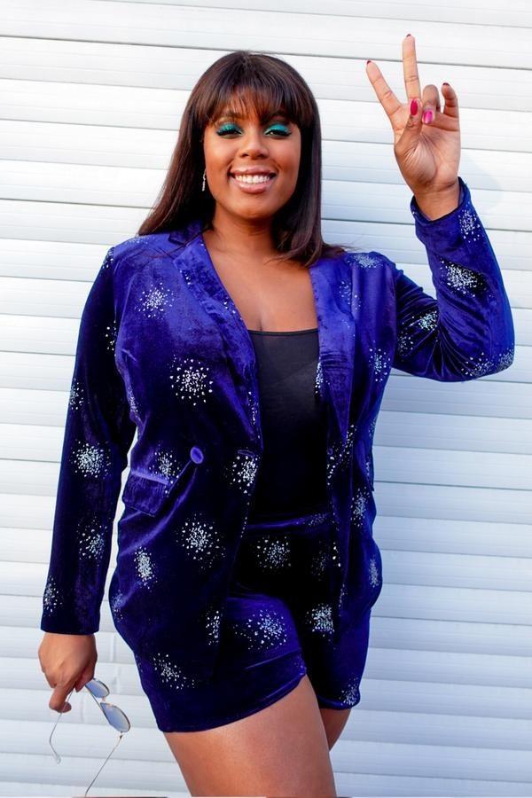 model wearing dark blue velvet blazer