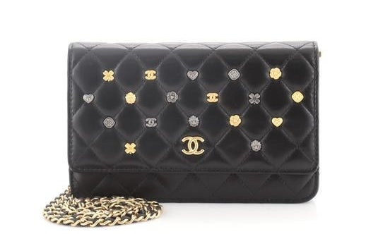 the black Chanel purse with gold chain
