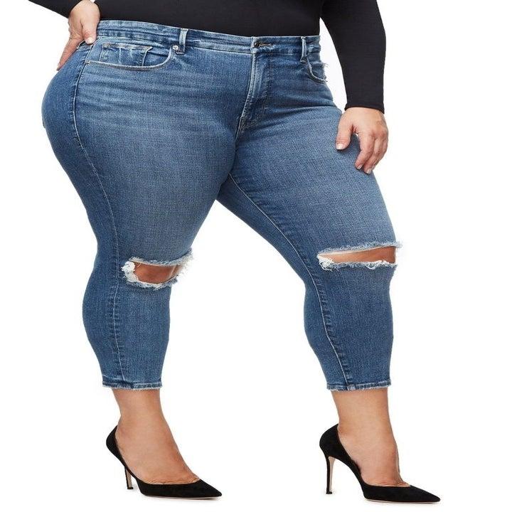model wearing blue ripped skinny jeans