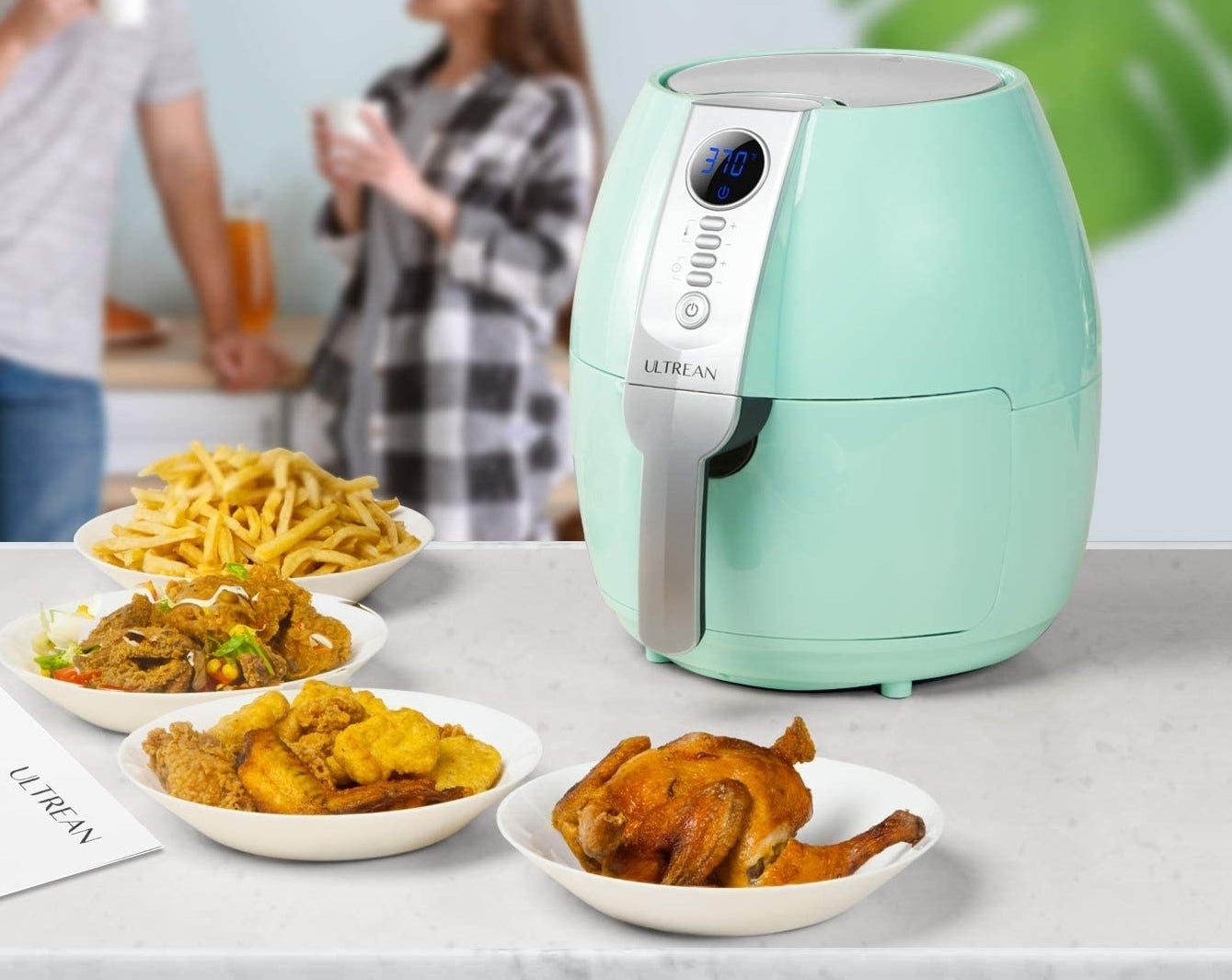 An air fryer surrounded by air fried foods