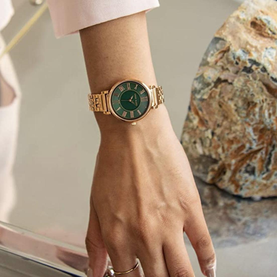 Model in a rose gold anne klein watch