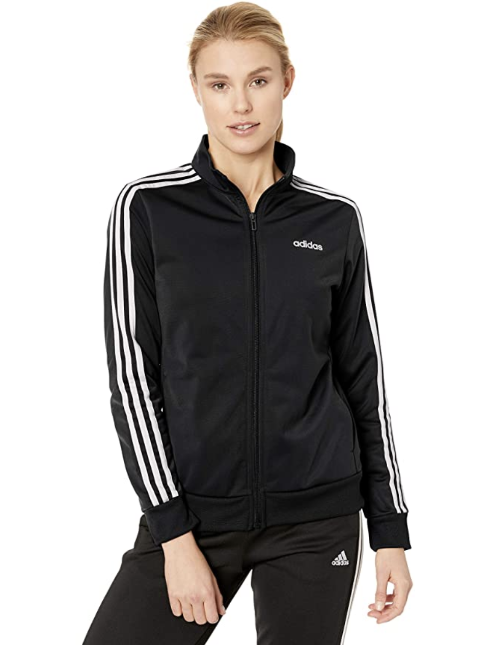 Model in a black zip Adidas track jacket with white strips down the sleeves