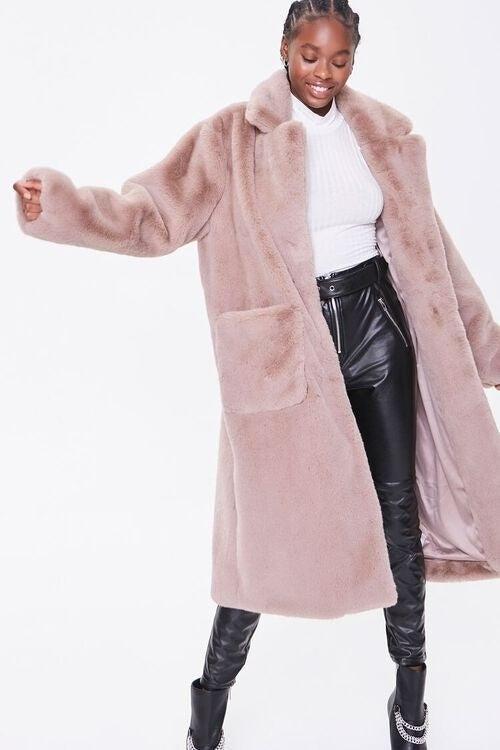 Model wearing the pink faux fur coat