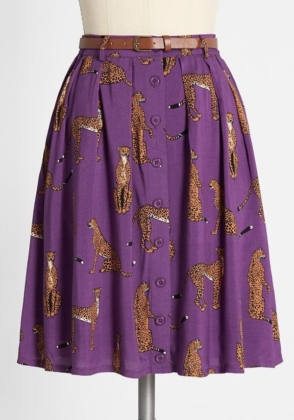The purple A-line, button-front skirt with a brown belt and with leopards on it