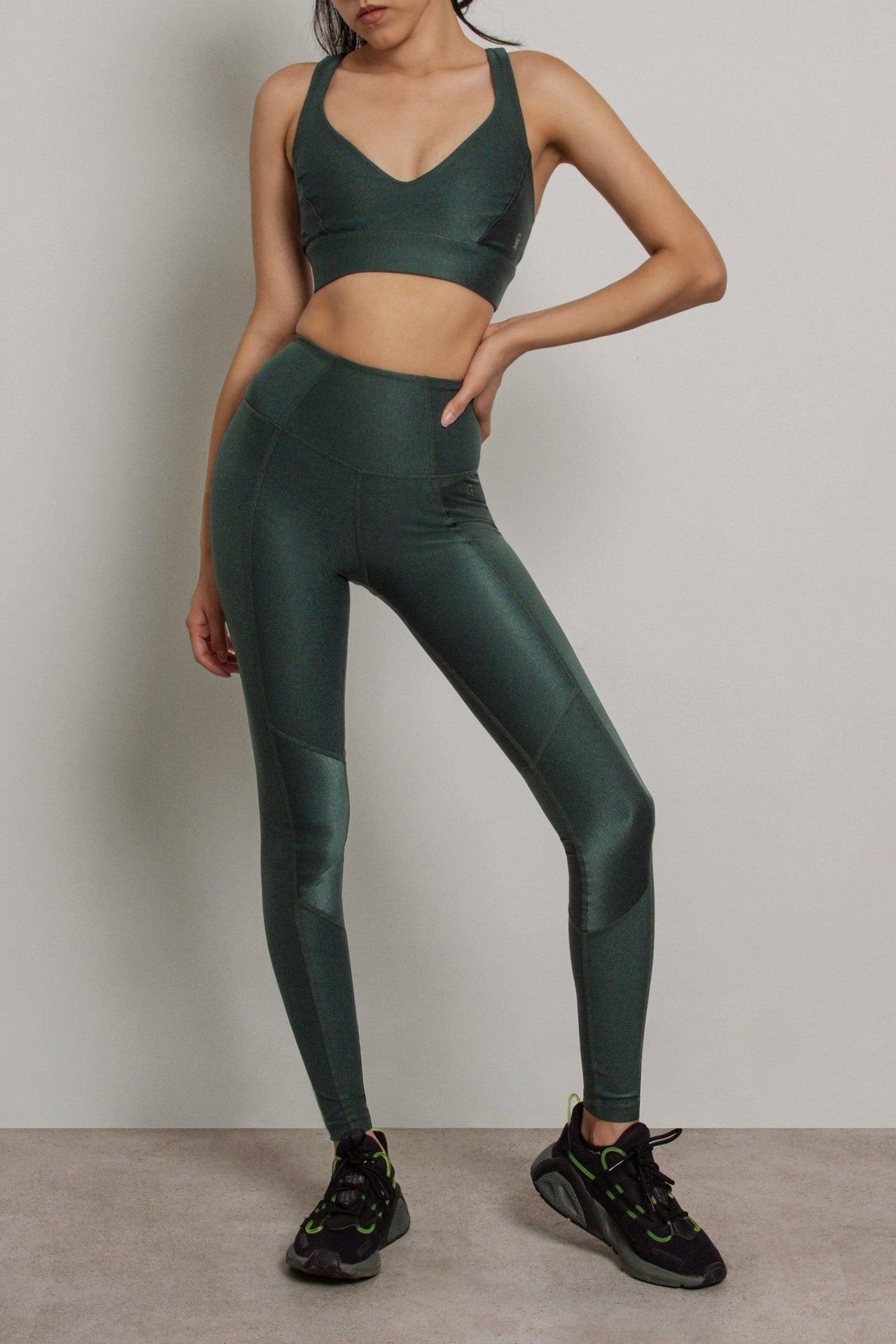 Model wearing the full-length leggings in green