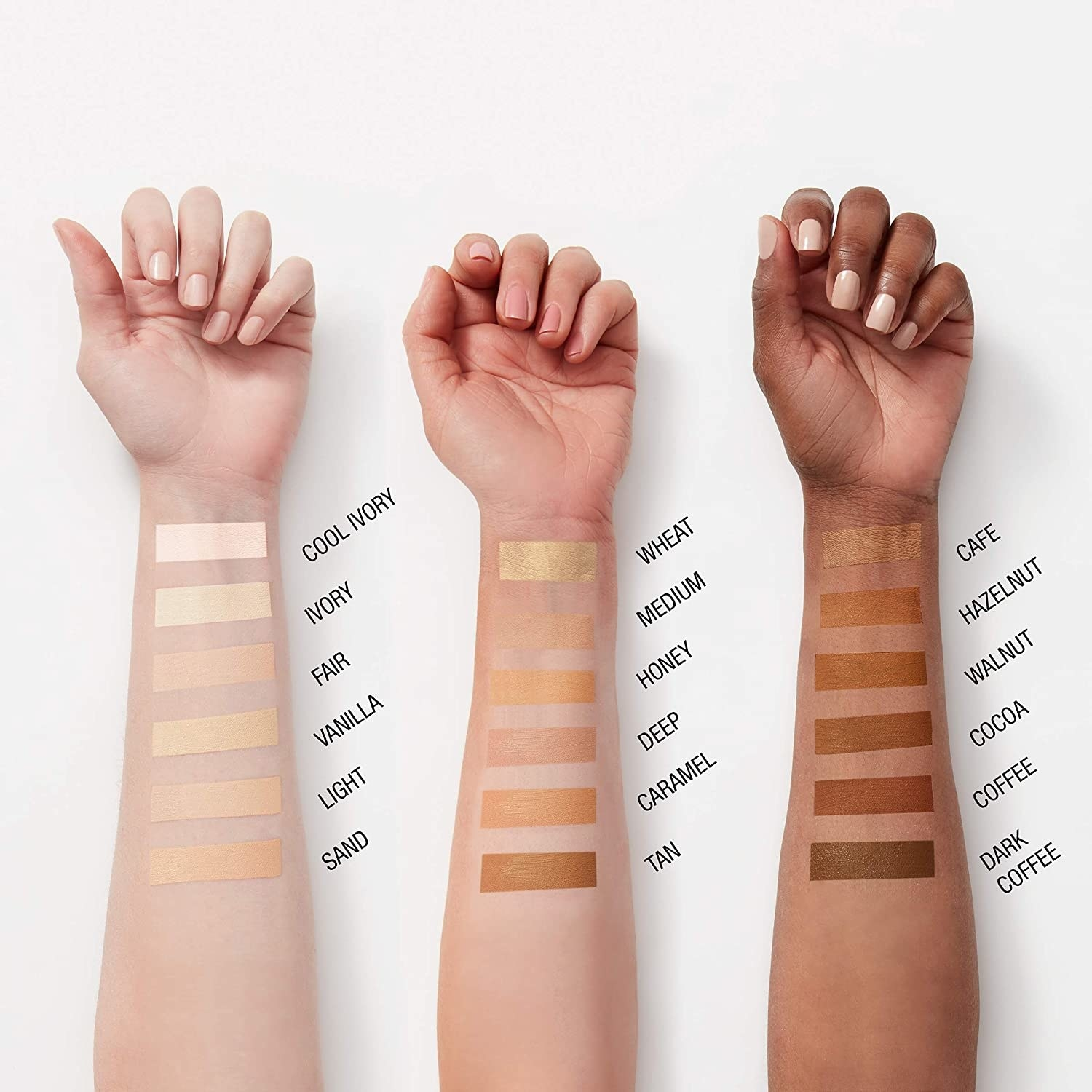 A trio of hands swatching the different shades of concealer