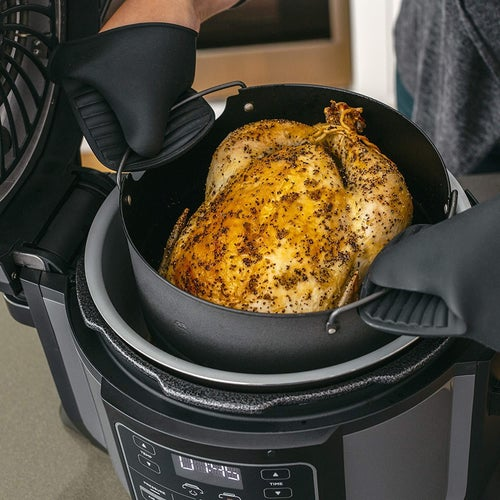 Mitts lift roasted chicken out of Ninja Foodi