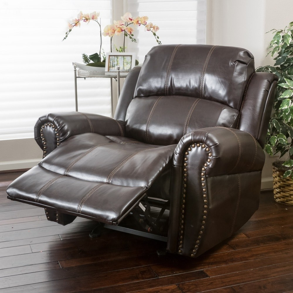 The brown recliner with gold studs
