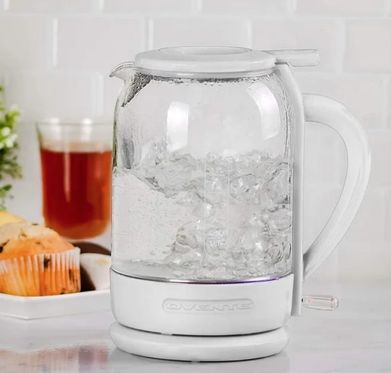 White electric tea kettle with water inside