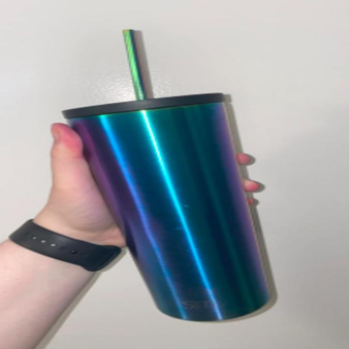 hand holding an iridescent drink tumbler