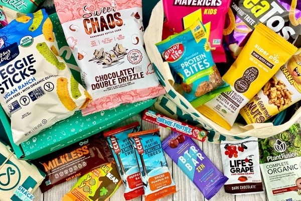 snacks like clif bars, veggie sticks, and protein bites