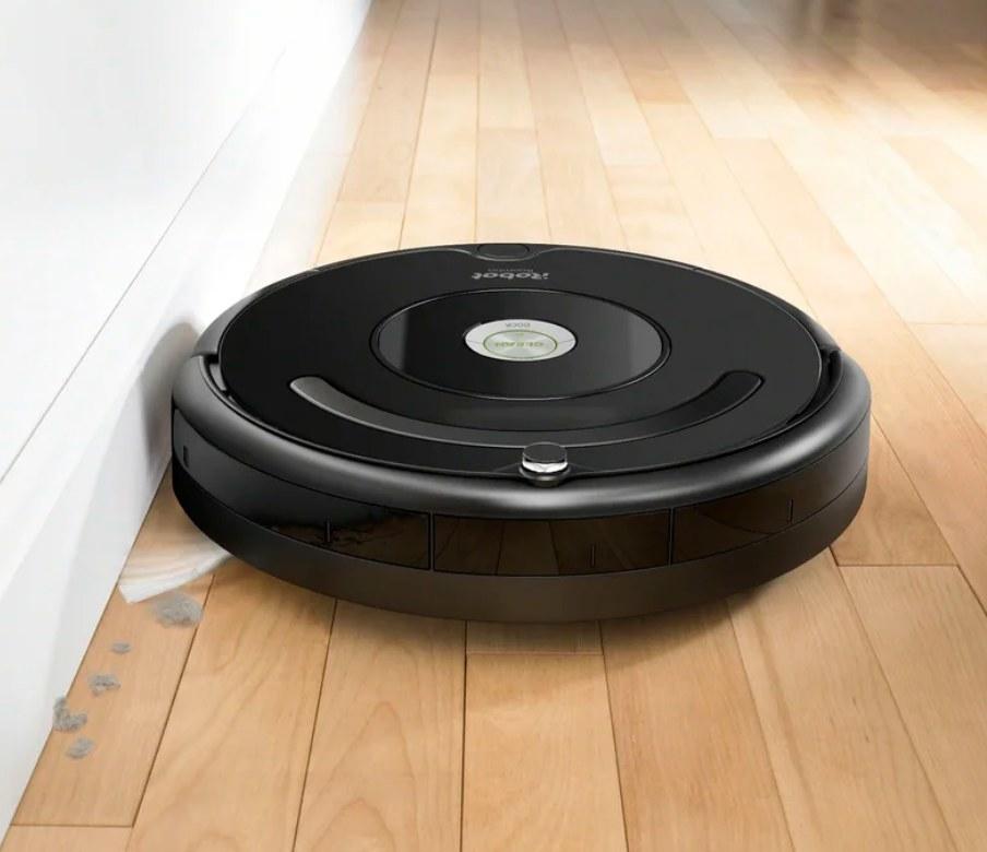 The black round roomba vacuum