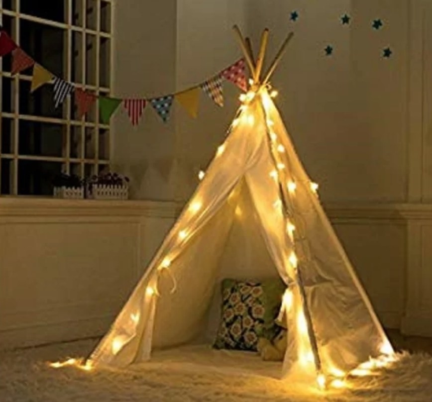 Teepee style white tent with lights