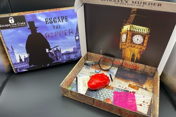 a box filled with sleuthing tools and clues