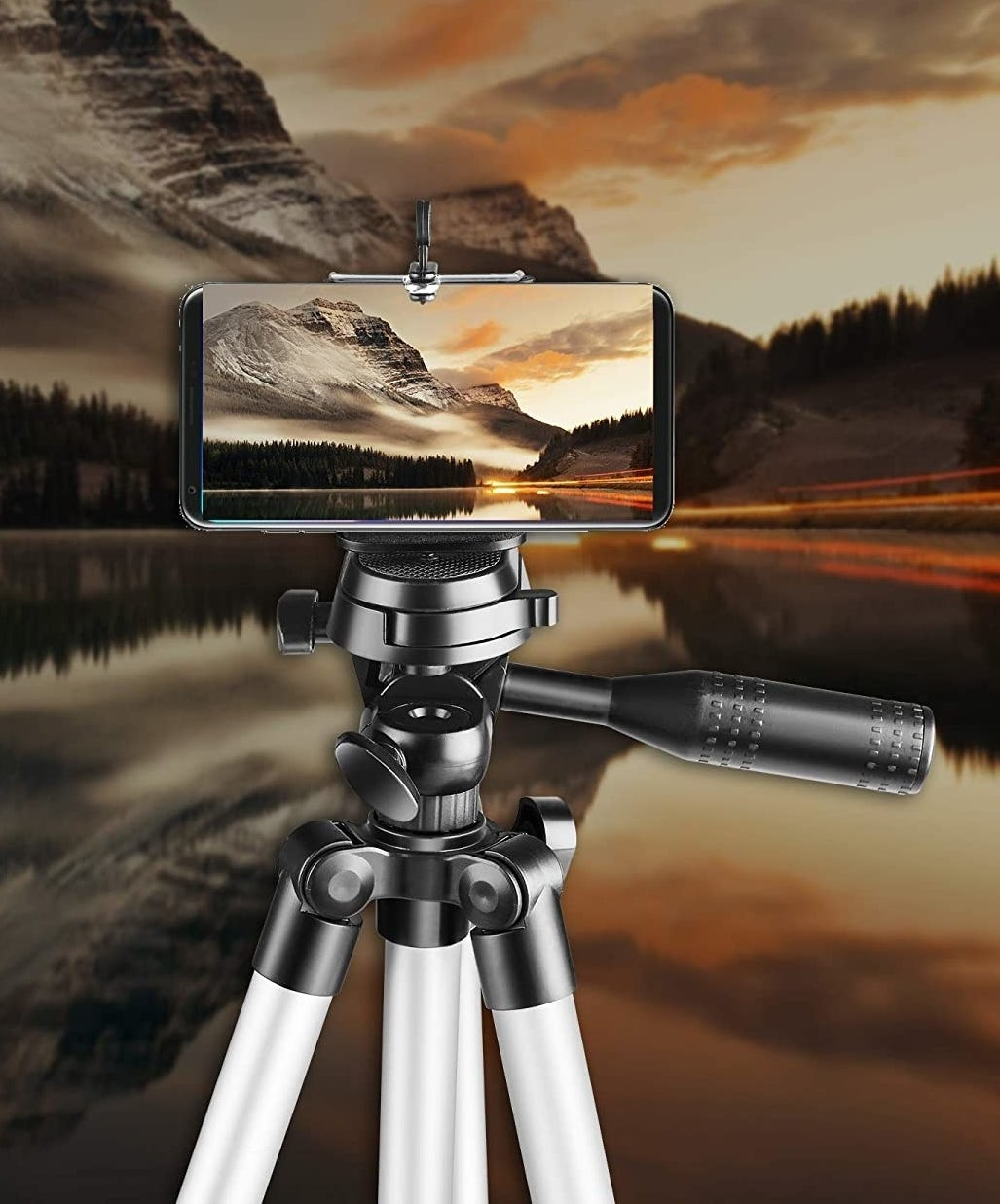 Tripod with smartphone attached capturing a beautiful scenery.