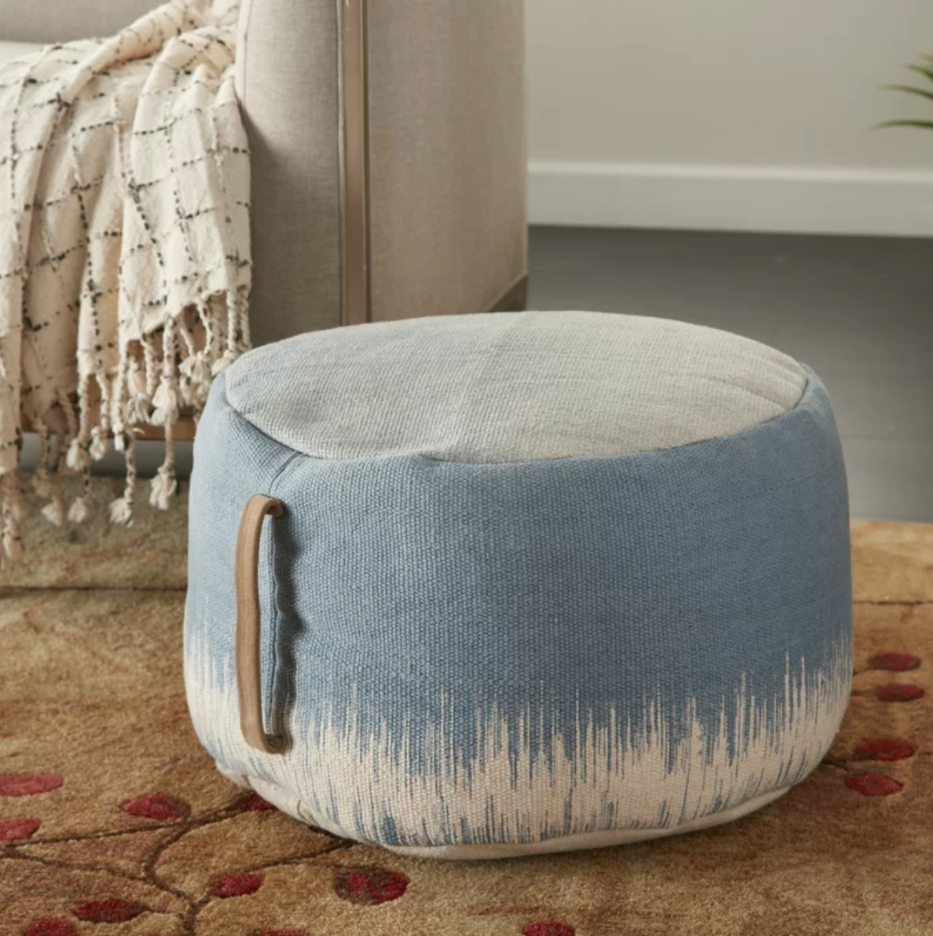 The abstract pouf in ocean blue/ ivory
