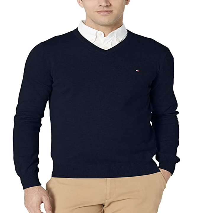 Model in a navy blue v-neck sweater