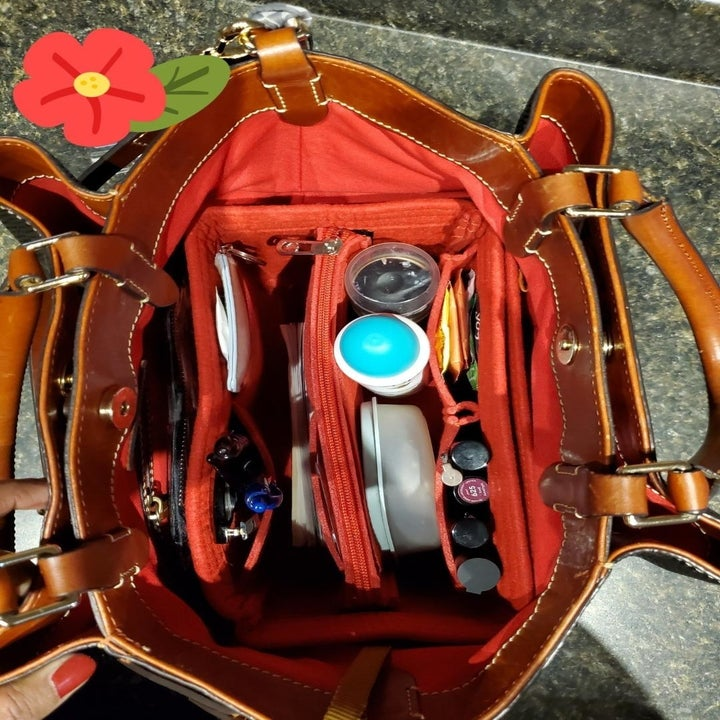 The orange organizer holding things in a reviewer's purse