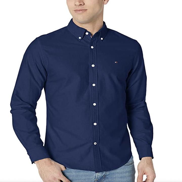Model in a dark blue button down oxford shirt