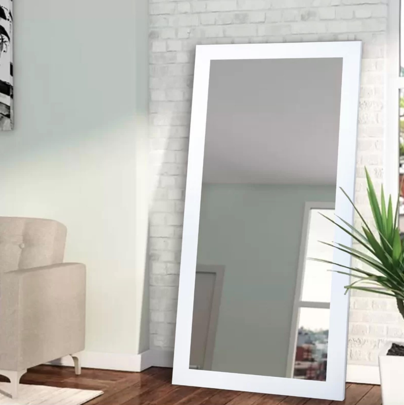 The full length mirror with a white frame
