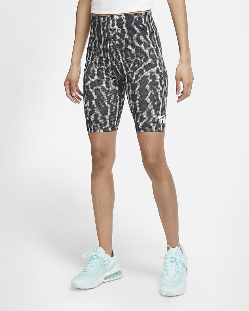 Model wearing the knee-length bike shorts with grey leopard print all over